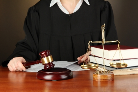 golden rule: Judge sitting at table during court hearings on black background