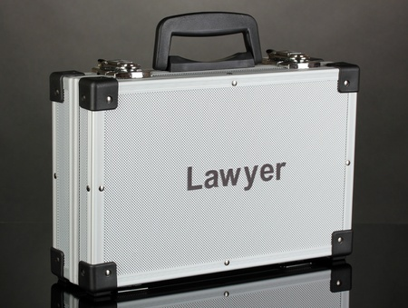 Silvery diplomat (suitcase) on grey background Stock Photo - 18143990