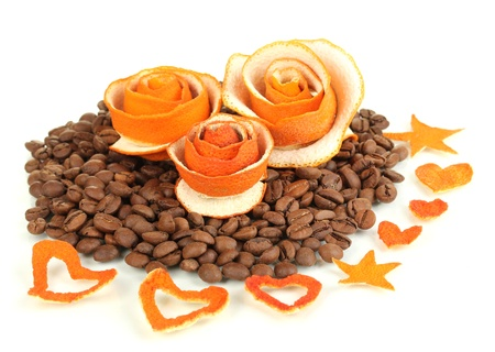 Decorative roses from dry orange peel on coffee beans heap Stock Photo - 18143174