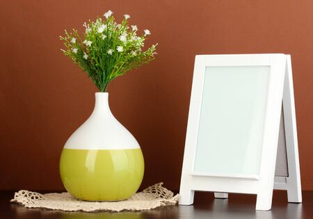 White photo frame for home decoration on brown background Stock Photo - 18143706