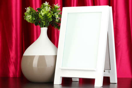 White photo frame for home decoration on curtains background Stock Photo - 18142364
