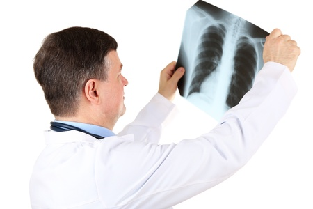 Medical doctor analysing x-ray image  isolated on white Stock Photo - 21541647