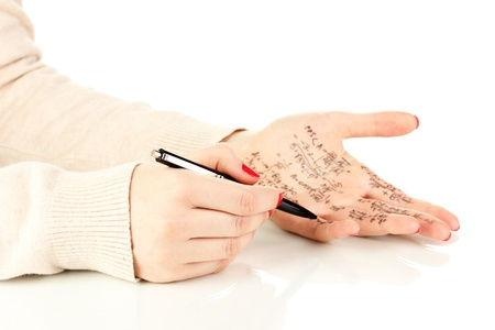 Write cheat sheet on hand isolated on white Stock Photo - 18142180