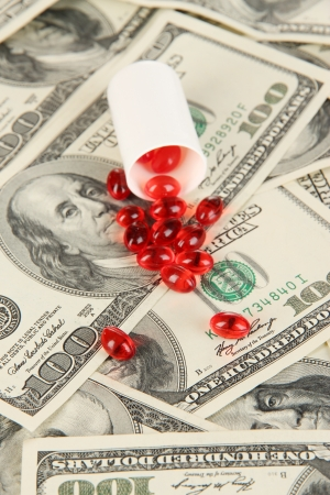 Pills and money close-up background photo