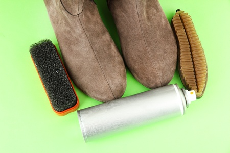 Set of stuff for cleaning and polish shoes, on color background Stock Photo - 18187389