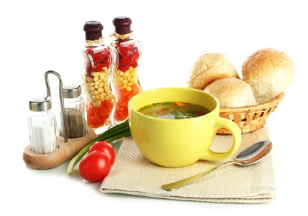 bread basket: Fragrant soup in cup isolated on white Stock Photo