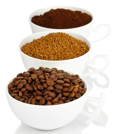 Different types of coffee in three cups isolated on white photo