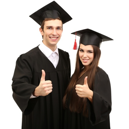 graduate students: Two happy graduating students  isolated on white Stock Photo