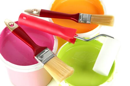 Set for painting: paint pots, brushes, paint-roller close up Stock Photo - 18186872