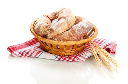 Taste croissants in basket isolated on white  Stock Photo - 18186879