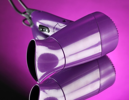 Hair dryer on purple background Stock Photo - 18217195