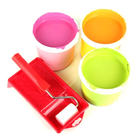 Set for painting: paint pots,  paint-roller isolated on white Stock Photo - 18216688