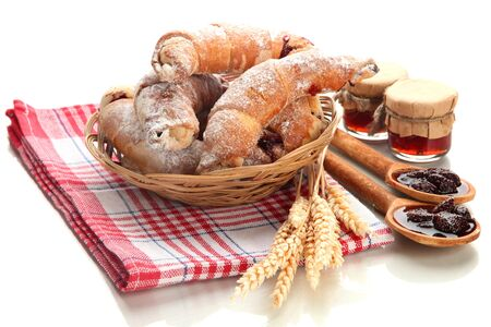 Taste croissants in basket and jam isolated on white  Stock Photo - 18231897