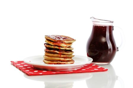 rubicund: Sweet pancakes on plate with condensed milk isolated on white