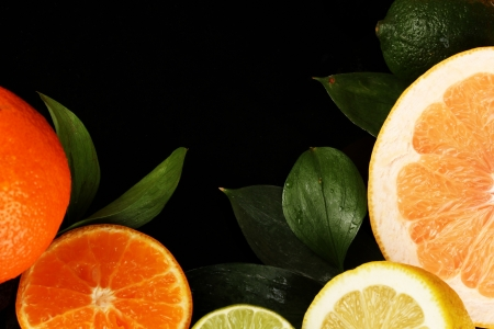 Lots ripe citrus isolated on black Stock Photo - 18295171