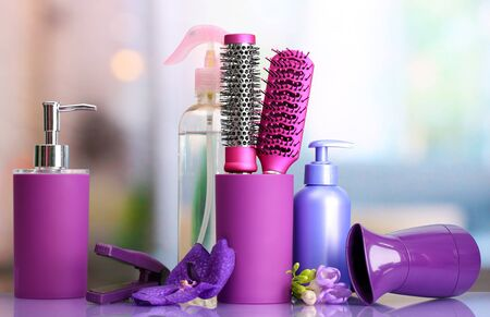 Hair brushes, hairdryer, straighteners and cosmetic bottles in beauty salon  Stock Photo - 18295137