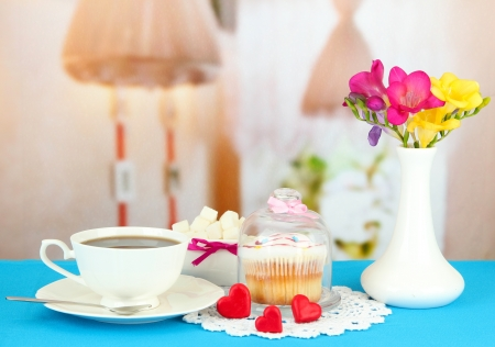 Cupcake on saucer with glass cover, on bright background photo