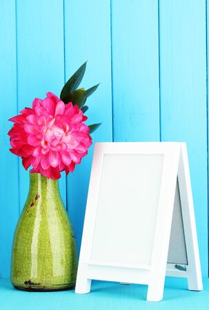 White photo frame for home decoration on blue background Stock Photo - 18295145