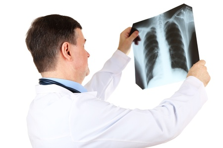 Medical doctor analysing x-ray image  isolated on white Stock Photo - 21542589