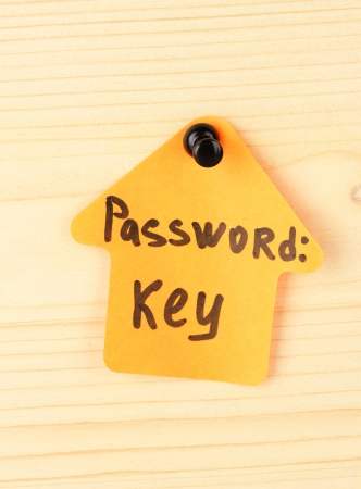 Sticker-reminder with most popular password, on wooden background Stock Photo - 18294923