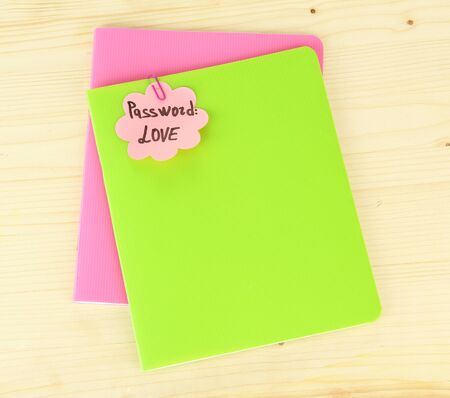 Sticker-reminder with most popular password, on notebook, on wooden background photo
