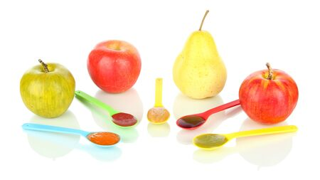 pureed: Baby puree in spoons with fruits isolated on white