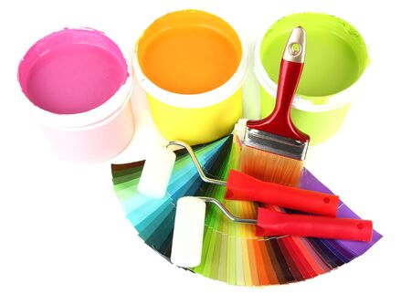 Set for painting: paint pots, brushes, paint-roller and palette of colors isolated on white Stock Photo - 18301195