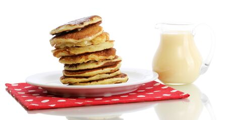maslen: Sweet pancakes on plate with condensed milk isolated on white