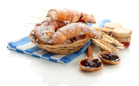 Taste croissants in basket and jam isolated on white Stock Photo - 18325273