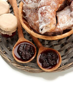 Taste croissants in basket and jam isolated on white Stock Photo - 18325621