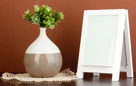 White photo frame for home decoration on brown background Stock Photo - 18326121