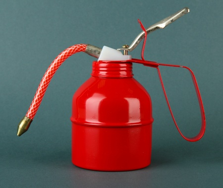 Red oil can, on color background Stock Photo - 18325968