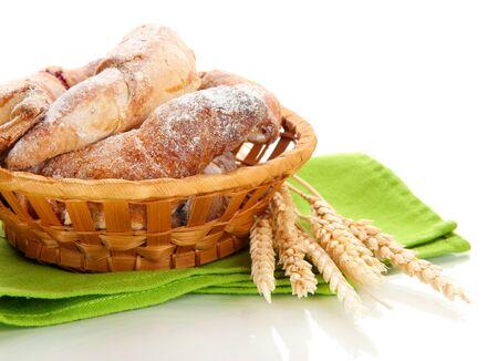 Taste croissants in basket isolated on white Stock Photo - 18326257
