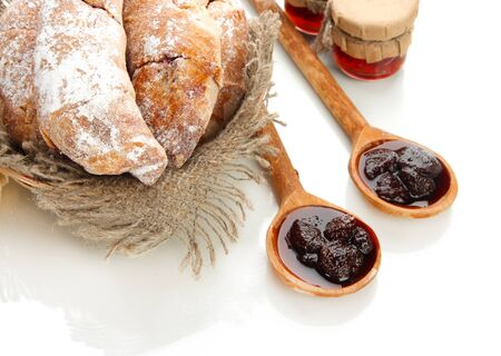 Taste croissants in basket and jam isolated on white Stock Photo - 18326426