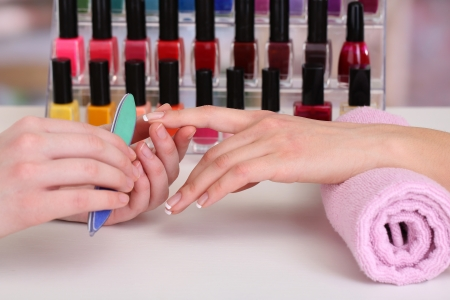 rasp: Manicure process in beauty salon, close up