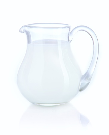 pasteurized: Pitcher of milk isolated on white