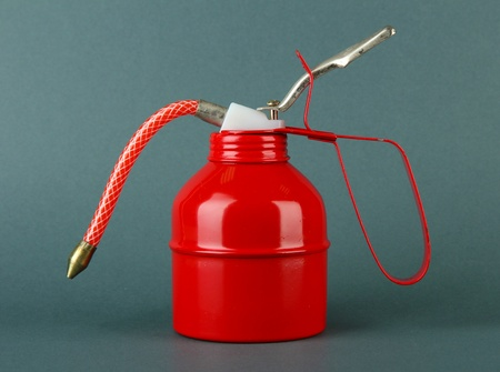 Red oil can, on color background Stock Photo - 18448569