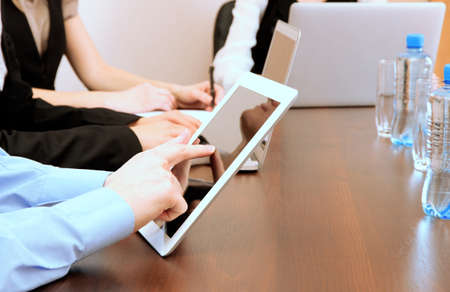 Male hands with digital tablet on office background. photo