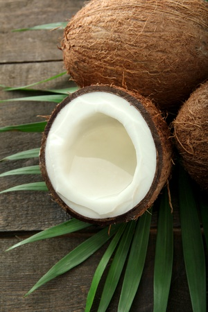 Coconut with leaves, on grey wooden background Stock Photo