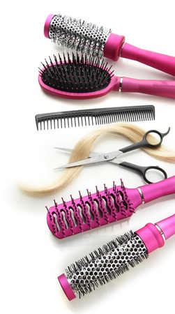 Comb brushes, hair and cutting shears, isolated on white Stock Photo - 18473794