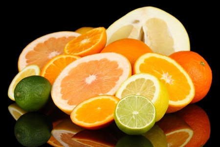 Lots ripe citrus isolated on black Stock Photo - 18473762
