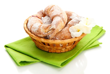 Taste croissants in basket isolated on white Stock Photo - 18473918