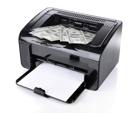 counterfeiting: Printer printing fake dollar bills isolated on white Stock Photo