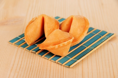 Fortune cookies on wooden table Stock Photo - 18475076