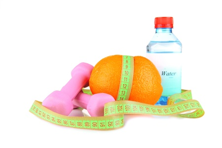 Orange with measuring tape, dumbbells and bottle of water, isolated on white Stock Photo - 18474567