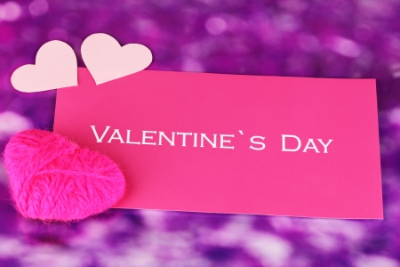 Greeting card for Valentines Day on purple background photo