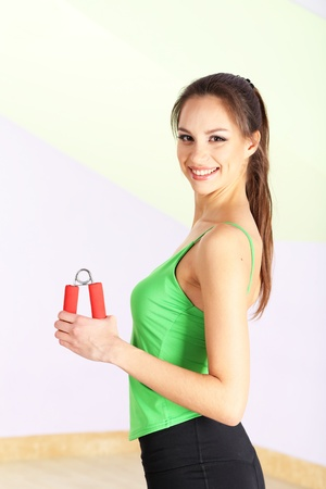 expander: Young woman with carpal expander at gym Stock Photo