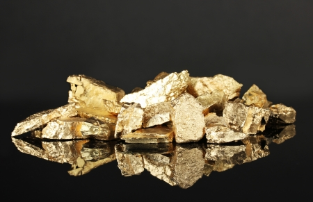Golden nuggets on dark background Stock Photo - 18490137