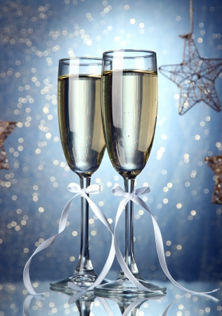 Two glasses of champagne on bright background with lights Stock Photo