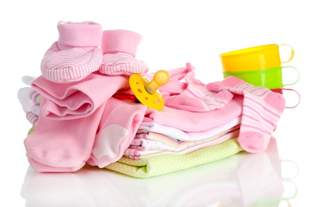 bootees: Pile of baby clothes isolated on white